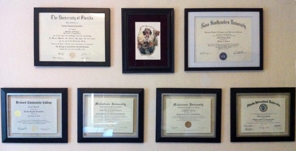 Asenath Waite with our Miskatonic and other school Certificates and Diplomas